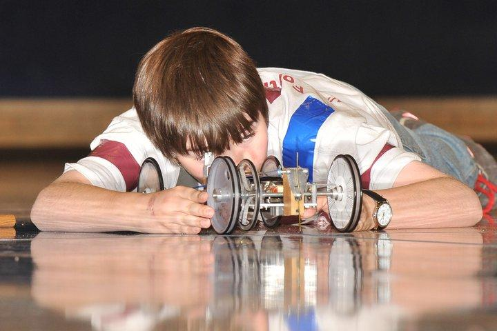 A Middle School student participates in the 2010 State Science Olympiad Battery Buggy competition.