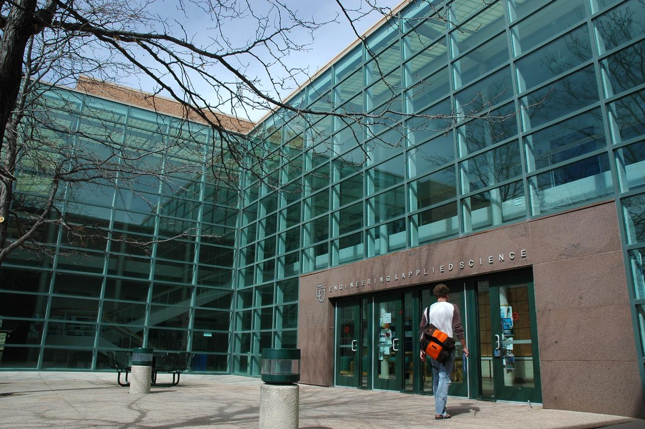A student enters the Engineering & Applied Science building