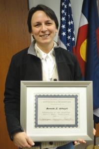 Benek Altayli holding a framed certificate