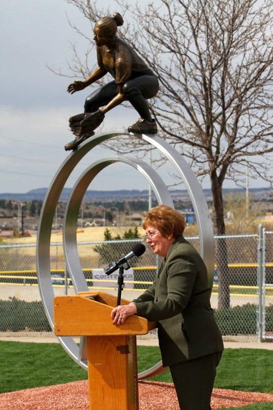 Chancellor Pam Shockley-Zalabak at a podium in front of the sculpture