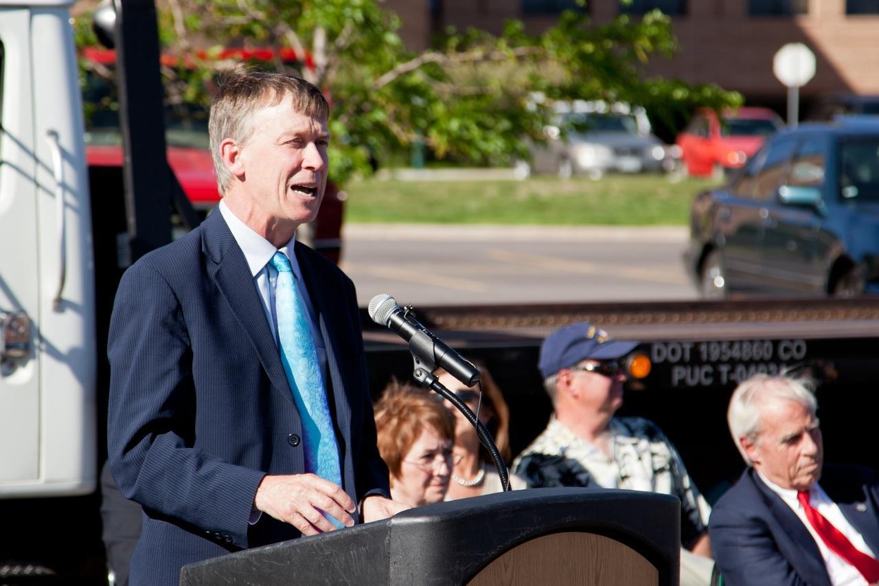 CO Governor Hickenlooper at a podium