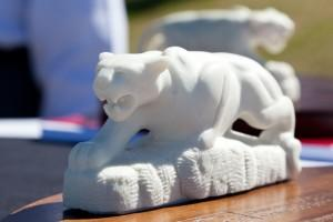 Small mountain lion sculpture handed out at the dedication ceremony
