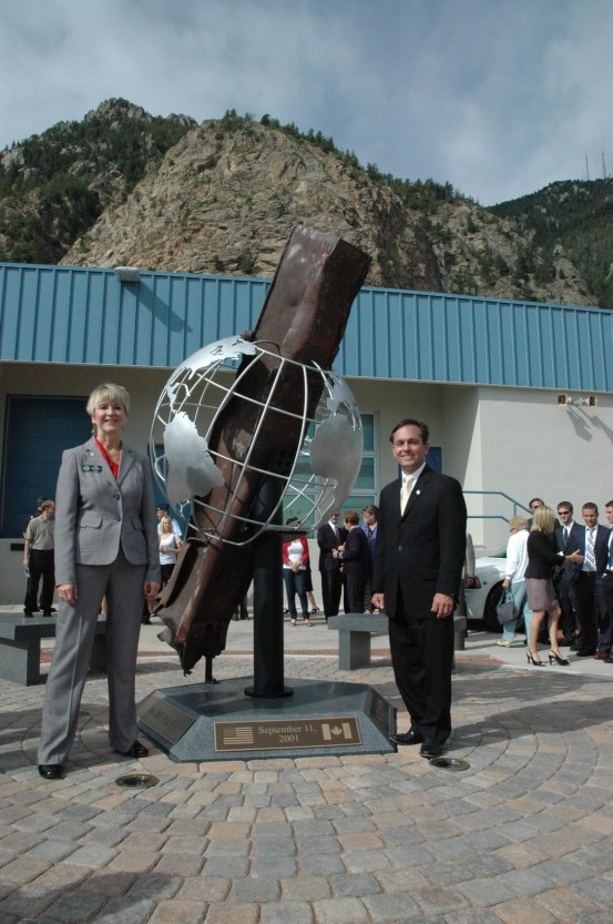 Regents stand by the artifact display at Cheyenne Mountain