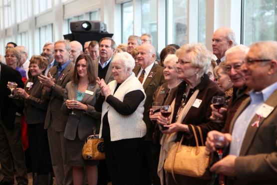 Audience members applaud the announcement of the Lanes' gift.
