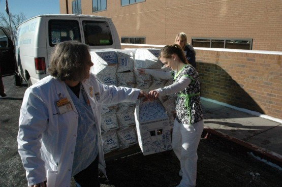 Sue Davis, instructor, Beth El College of Nursing, helps Valerie Walker, a Beth-El senior, unload teddy bears bound for Children's Hospital.