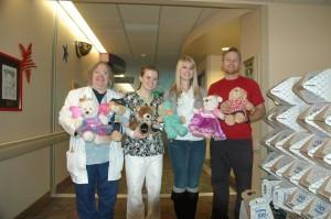 Members of the Student Nurses Association delivered teddy bears to Children's Hospital on Tuesday. From left: Sue Davis, instructor, Beth-El College of Nursing and Health Sciences, Valerie Walker, senior, Amy Digan, senior, and Kelley Millsap, a Beth El alumnus.