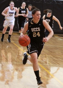 Jeri Pikul, junior, moves the ball down court during the UCCS Blackout game against Western New Mexico University on Feb. 1, 2013.