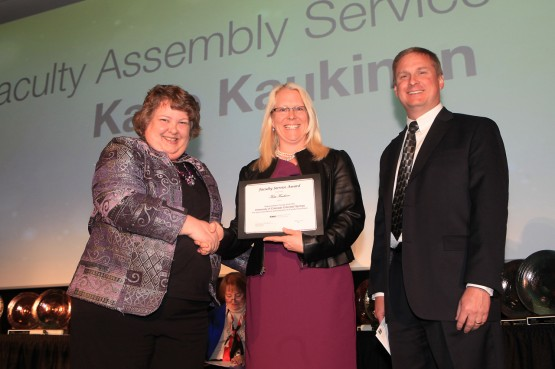 Andrea Hutchins and Jim Spice present Katie Kaukinen with the Faculty Assembly Award
