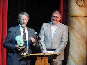 Randy Dipner, left, presents Drew Martorella with a Henry Award July 22