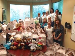 Student nurses pose with the more than 160 bears built delivered to Children's Hospital at Memorial Central.