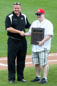 Sky Sox President and General Manager Tony Ensor shakes hands with Trent Hale, the first recipient of the Sky Sox Sports Management Scholarship, at Security Service Field.  Photo courtesy of Paat Kelly.