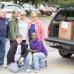 A group of Beth-El College of Nursing and Health Sciences faculty and staff pause during the loading of more than 1,000 items destined for Clyde's Cupboard. From left: Steve Campbell, custodian, Facilities Services; Susan Garrett, instructor; Diane Busch, program manager; Linda Matthies, program manager; Sharon Clark, program manager; Art Drummond, custodian, Facilities Services.