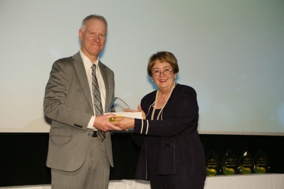 Chancellor Shockley-Zalabak presents the Chancellor's Award to Eric Olson