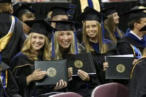 Samantha Wood (left), Megan Gallegos (center) and Shawna Rogers (right) pose after receiving their Masters of Business Administration