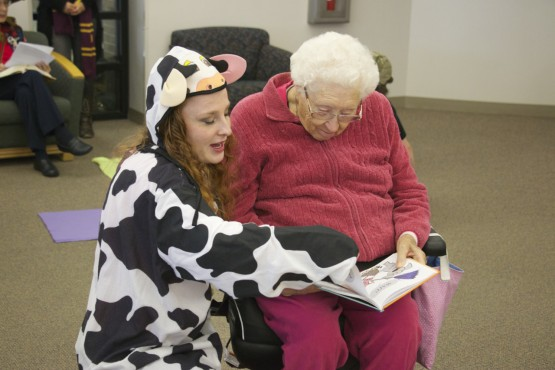 VAPA student Taylor Gross dressed as a cow while assisting Lola Satterfield read a Dr. Seuss story