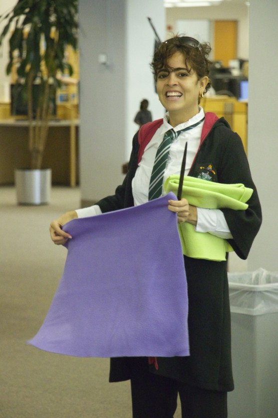 VAPA student Kalinka Caldas Premawardhan hands out nap-mats to participating students