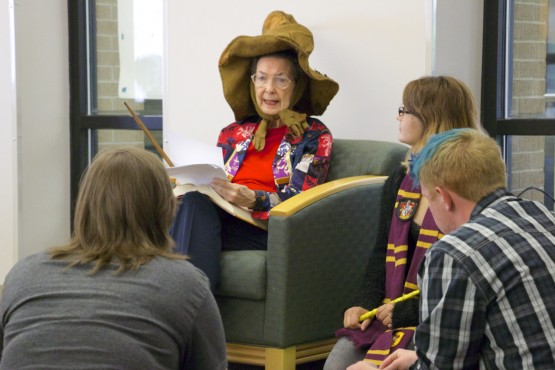 "Wanita Morgan read from ""Harry Potter and the Deathly Hallows"" while wearing the famed Sorting Hat and holding a wand"