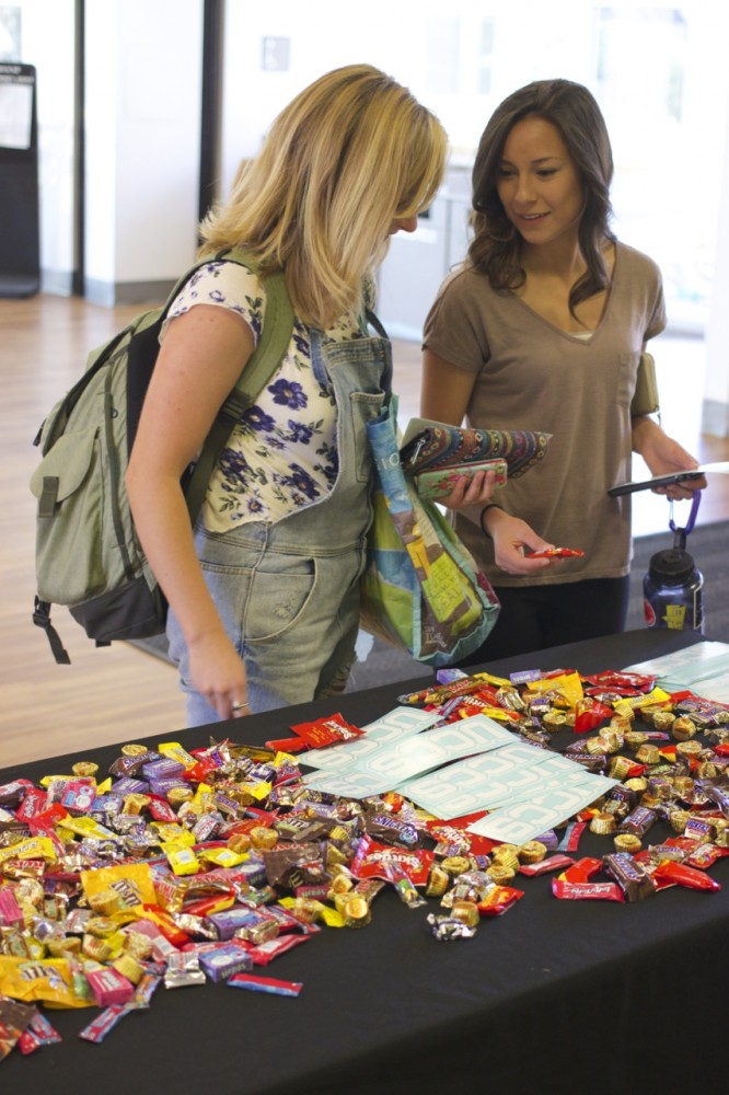 Students enjoy free candy on their way to class as part of Mountain Lion Community Week