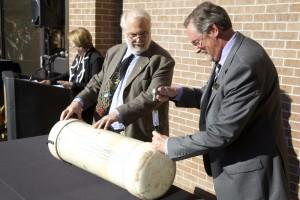 Jeff Davis, executive director, Auxiliary Operations and Steve Gnadt, former director, University Center, open the 1988 time capsule