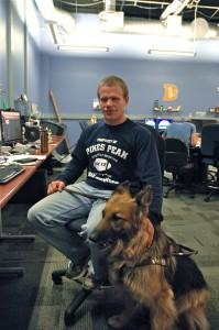 Terry Garrett, a member of the class of 2012, with his service animal, Clover.