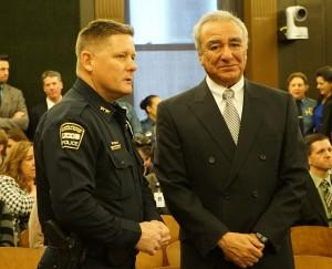 UCCS Police Chief Brian McPike converses with Rob Aguilar who was Officer Garrett Swasey's father-in-law during a ceremony at Colorado Springs City Hall.
