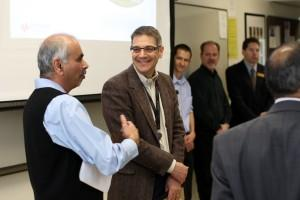 T.S. Kalkur, professor, College of Engineering, converses with Dave Cipriani of Keysight Technologies following a March 28 presentation.