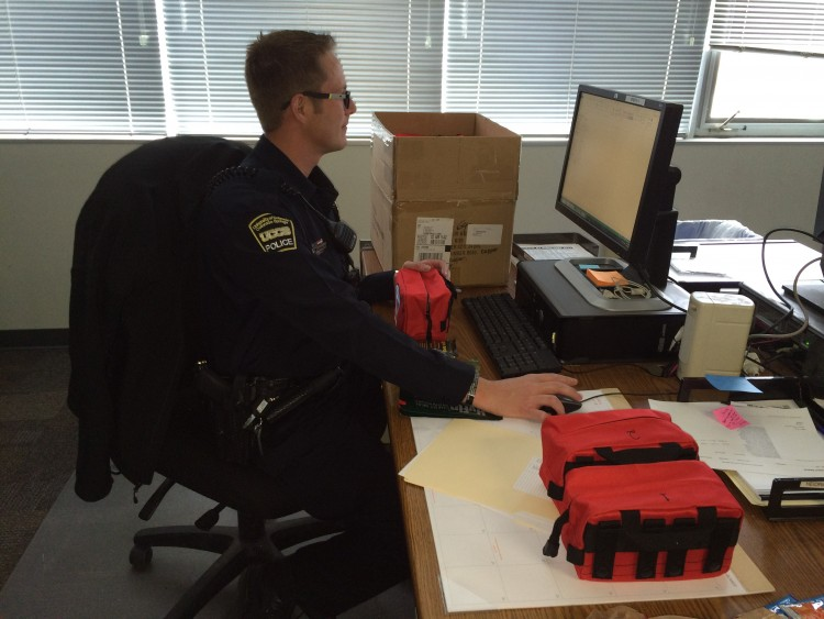 Police Officer Jerod Heidrick logs new trauma kits into the Police Department's equipment inventory.