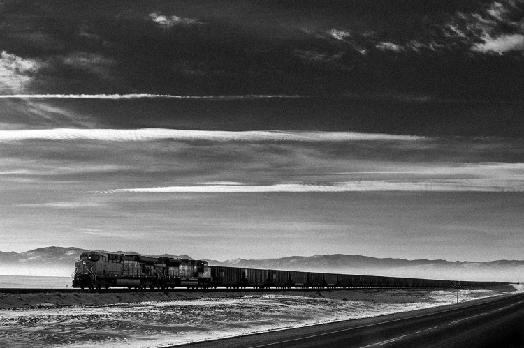 """China Express: Powder River Basin Wyoming to Cherry Point Washington: Mining - Transporting - Exporting to China"" by Carlan Tapp, silver gelatin photograph 2013."