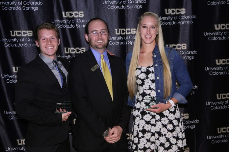 Thomas F. McLaughlin Award winners. Cort Searls and Kim Catlett pose with Jared Verner, assistant athletic director