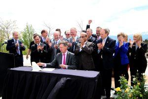 Gov. John Hickenlooper signs the Colorado Cybersecurity Initiative bill into law at UCCS on May 20.