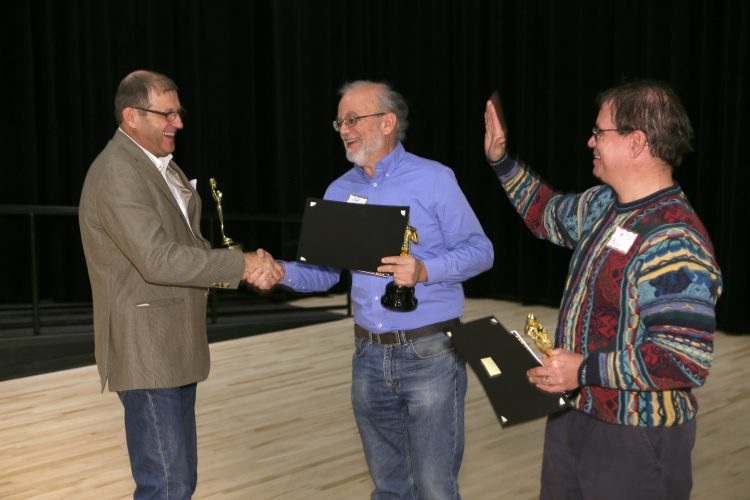 From left: Professors Celinski, Camley and Boult congratulate each other during an Oct. 19 celebration of research.