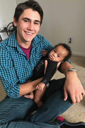 Matthew Barnes with a baby