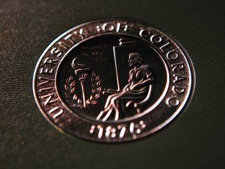 CU diploma cover at commencement