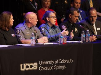 Panel discussion with police at a town hall event.