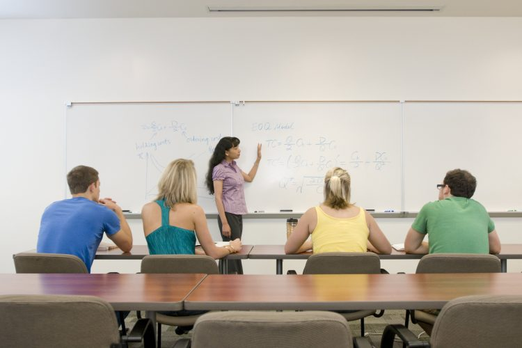 A professor leading a small class.