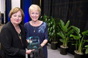 Pam Shockley-Zalabak poses with the award with Karen Possehl