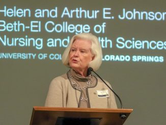 Nancy Smith speaks at a podium