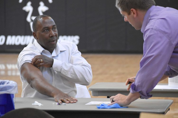 Vice Chancellor Bakari prepares for his flu shot