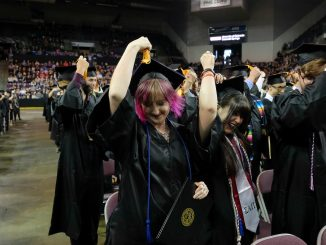 Student at commencement moves her tassel