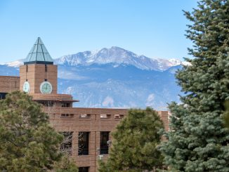 Clock tower with Pikes Peak during winter.