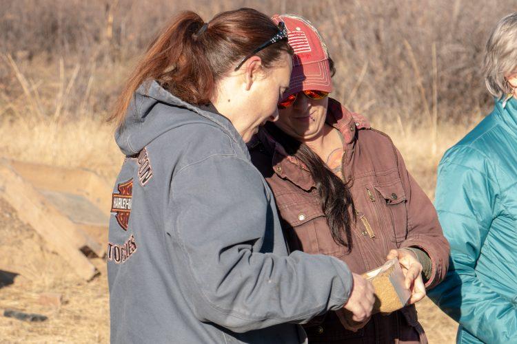 Students examine artifact