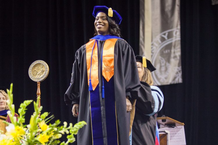 Terainer Brown receives her doctoral degree
