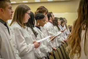 Nursing students take the oath to patient care.