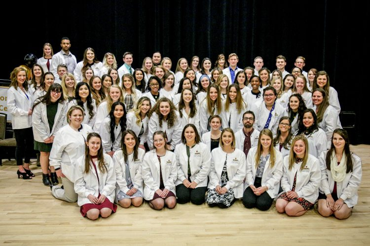 Nursing students with their white coats