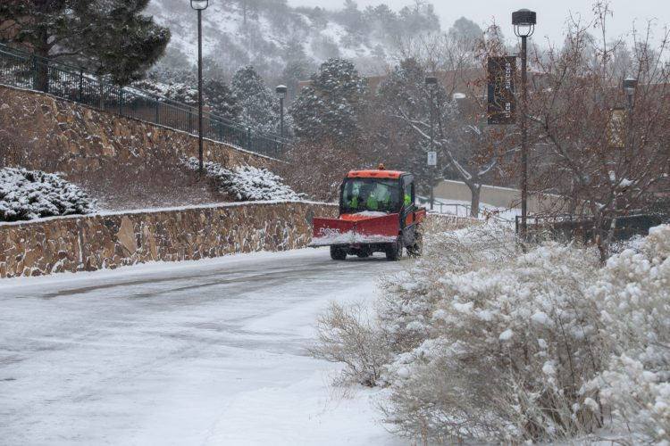 Facilities Services vehicle drives in snow Feb. 18