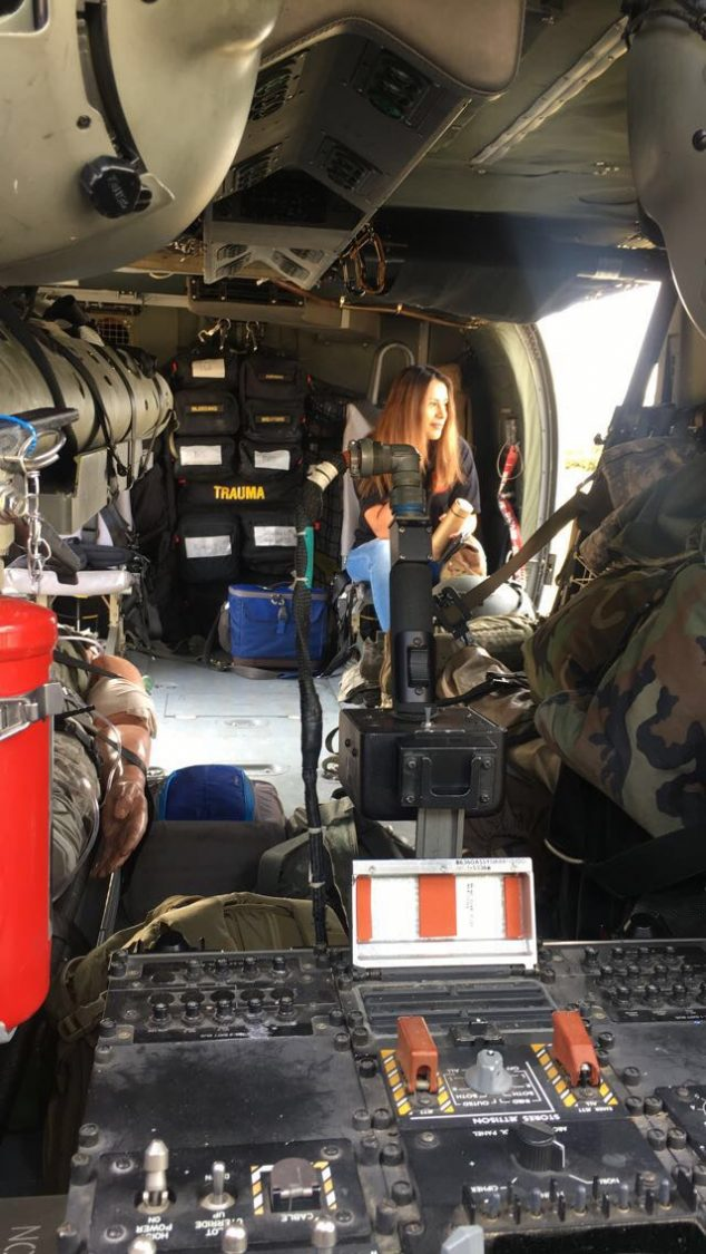 A student sits in the transport area of a helicopter.