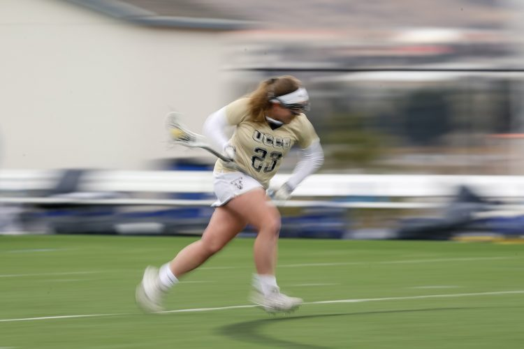 Women's Lacross player steals the ball