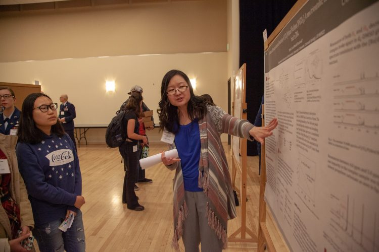 Zexin Li makes a poster presentation