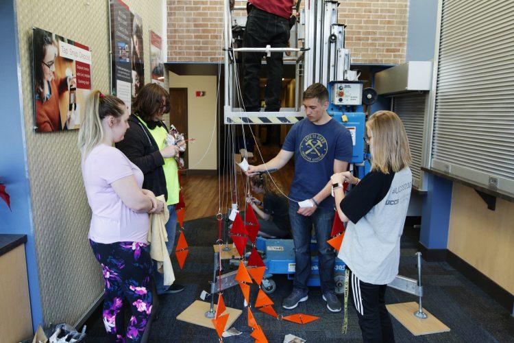 VAPA students hang the installation