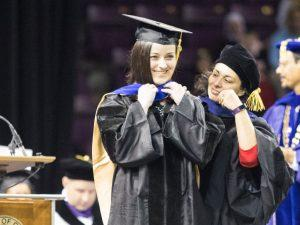 Alyssa Ortiz is hooded at commencement
